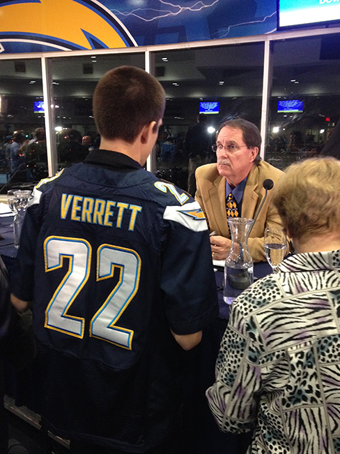 A Chargers fan questions Citizens Stadium Advisory Group member Walt Ekard. (Photo by Jeremy Ogul)
