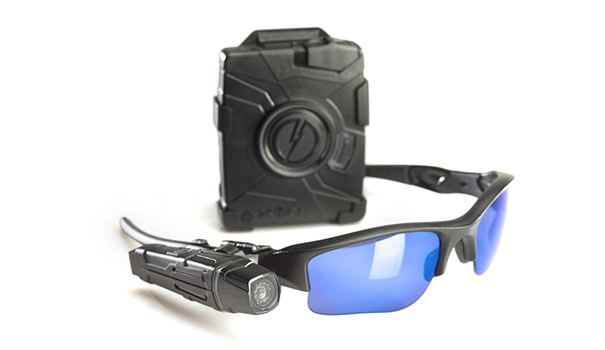 TASER AXON flex Camera with Controller and Oakley Flak Jacket Glasses (PRNewsFoto/TASER International, Inc.)