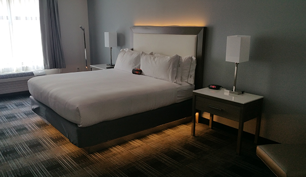 A room with a king-size bed features soft and hard pillows, recessed lighting, and free Wi-Fi. (Photo by Ken Williams)