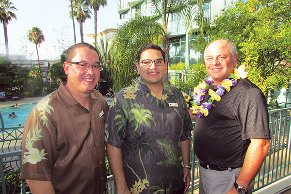 (l to r) Doubletree Director of Sales Michael G. de Jesus, Doubletree General Manager Victor H. Ravago and Portfolio Hotels & Resorts Chief Operating Officer Graham Hershman (Photo by Vincent Meehan)