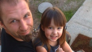 Tattoo artist Forrest Lang with his young daughter (Courtesy Brian Mahoney)