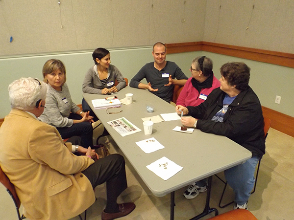 Group of people chat at the Death Cafe