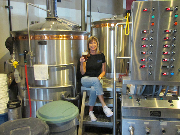 Barbara Hurst samples the new Station 45 craft beer, made in honor of the new fire station in Mission Valley. (Courtesy of Oggi's Restaurant and Brewhouse)