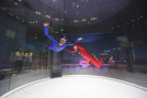 "SDCNN editor Jeff Clemetson ""skydives"" indoors under the watchful eye of instructor Nick Flo. (Courtesy of iFLY San Diego)"