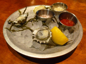 A pair of Kumamoto oysters on ice