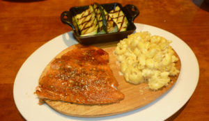 Spice-rubbed wild Alaskan salmon with grilled zucchini and mac 'n' cheese