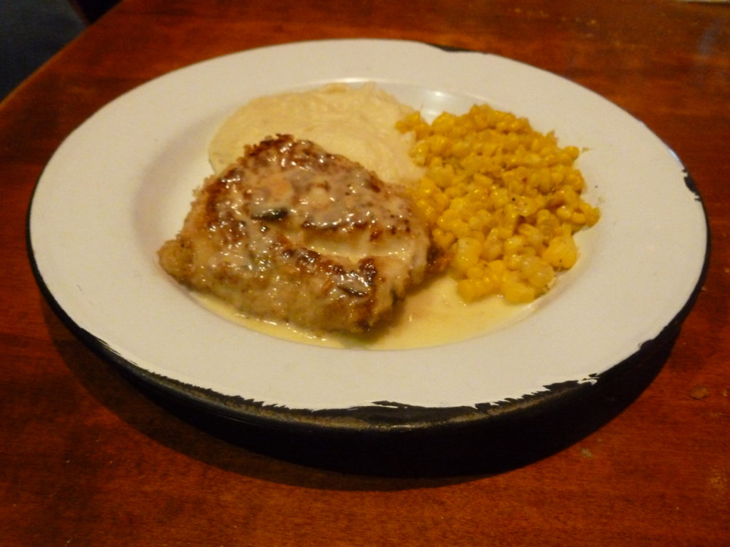 Walnut-crusted white sea bass in lemon sauce with corn and mashed potatoes