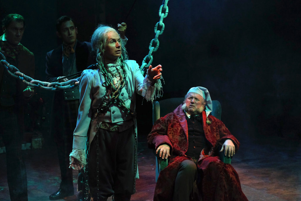 "David McBean (left) as the Ghost of Christmas Past and Tom Stephenson as Ebenezer Scrooge in Cygnet Theatre's ""A Christmas Carol"" now playing at Olt town Theatre (Photo by Ken Jaques)"