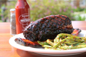 Ribs are all the rage in December. (Courtesy Wood Ranch BBQ & GRILL)