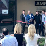 AMP&RSAND cuts ribbon, signs tenant